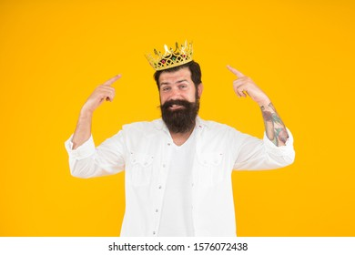 King crown. Love yourself. Holiday carnival celebration. brutal guy prince yellow background. King of party. Egoist selfish man. Superstar concept. Royal status. Sense of self importance.