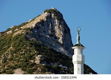 King Fahad Bin Abdul Aziz Al Saud Mosque spire with the rock to the rear, Gibraltar, United Kingdom, Western Europe.