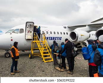 King George Island, Antarctica - December 27, 2016: People using a biosecurity boot wash while boarding an Antarctic Airways flight at remote airport on the South Shetland Islands