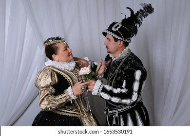 King Henry and Queen Marguerite of Navarre. Historical reconstruction of medieval costumes. Family Scene of the French Royal Couple in 16th century.
