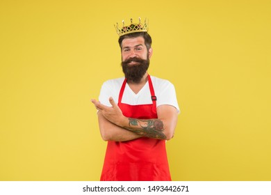 King of kitchen. Cook with beard and mustache yellow background. Royal recipe. Man mature cook wear cooking apron and golden crown. Ideas and tips. Chief cook and professional culinary. Cook food.