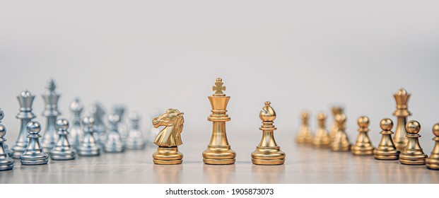 King and knight and rook chess standing on chess board with chess team in the back concepts of business team and leadership strategy and organization risk management.