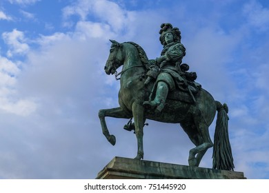 King Louis XIV statue in front of Palace of Versailles, France, September 2017