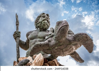 King Neptune statute, famous tourist attraction at Virginia Beach, against a cloudy sky