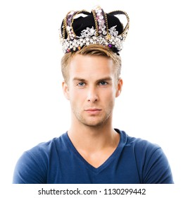 I am a king! Portrait of serious young man in crown, isolated against white background. Leadership and success concept.