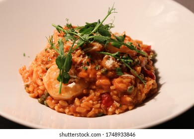 King prawn arrabbiata risotto with parmesan crisp and herb oil