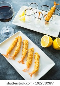 King Prawn served with sauce and lemon. Prawn with glass of red wine