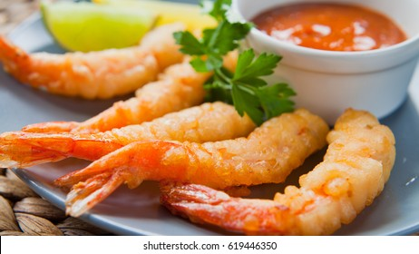 King Prawn Tempura -  Japanese dish , battered deep fried seafood  - Tiger Prawns . Served with sauce, lime and lemon.