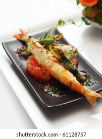 King prawn with vegetable tempura and saffron, served with tomato salsa placed on black platter