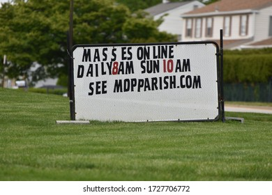King of Prussia, PA/USA-May 9, 2020:  Sign at Mother of Divine Providence Church advertising Masses Online.  During the Pandemic churches are congregating virtually.