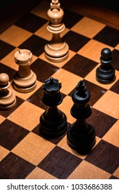 King, Queen, Chess tower on a wooden board viewed from above