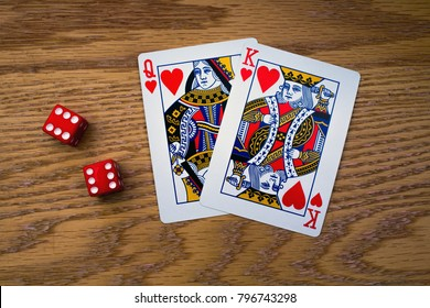 The King and Queen of Hearts and Two Red Die with Double Sixes