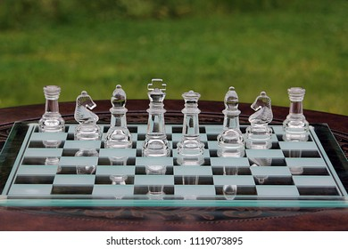 King and Queen on Chess Board with Bishops, Knights and Rooks