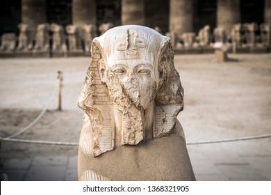 King Ramses II head statue at Karnak Temple, in the east bank of the Nile River, El-Karnak, Luxor, Egypt