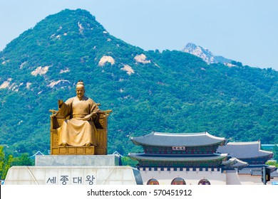 King Sae Jong Dae, engraved under statue in Korean, sitting with Gyeongbokgung Palace gate (Gwanghuamun: written in Chinese), Bugaksan mountain, tourist landmarks at city center, Seoul, South Korea