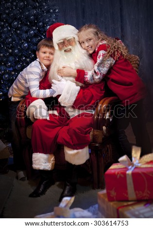 The Christmas Clause.King Santa Clause Giving Christmas Presents Stock Photo