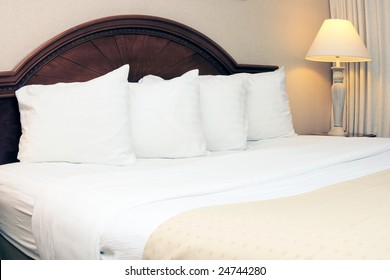 King size bed in a hotel room
