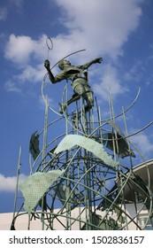 King of Smash sculpture was built in front of PB Djarum badminton center building, Kudus, Jawa Tengah, Indonesia 1 July 2011