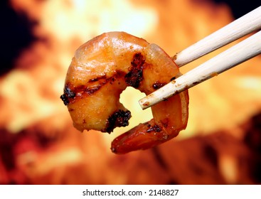 King tiger prawn shrimp with chop sticks by bbq fire, macro close up, copy space