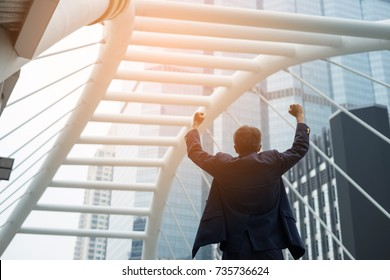 King of the world, Successful businessman raising hand in front of the smart building. business success concept.