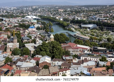 Kingdom of Georgia, Tbilisi (Tiflis): Skyline with red roofs of the Georgian capital with river, houses, churches and horizon in the background.