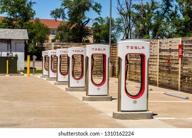 Kingman, Arizona, USA - May 12, 2016: Multiple Tesla chargers in Arizona. Tesla Supercharger is a 480-volt fast-charging station from Tesla Inc. for their all-electric cars.