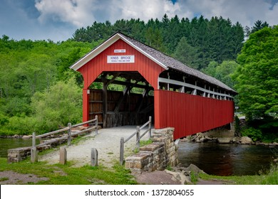 Kings Bridge Red wooden Covered Bridge restored and classic of the past bridge construction.  Located in Pennsylvania.