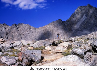 KINGS CANYON, CALIFORNIA - AUG 15,  1971 - Backpacker hiking cross country in the Evolution area of Kings Canyon National Park, California