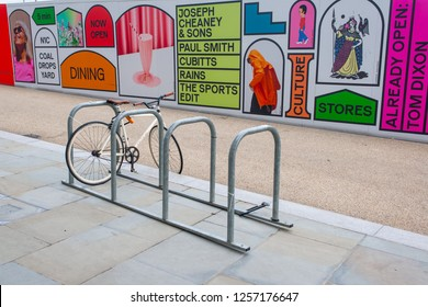 Kings Cross, London, England UK - November 2018: Fixed gear road hipster bike parked in front of billboards promoting the new venue Coal Drops Yard on King's Boulevard, Kings Cross.