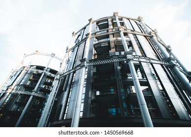 King's Cross London, UK, July 12, 2019: Granary Square residential building iron colums structure gas holder