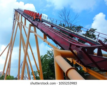 Kings Island, Ohio / USA - July 27, 2016 -  Riders at Kings Island enjoy the suspense as they head to the top of the 215 foot tall drop on Diamondback, a B&M roller coaster.