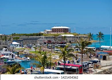 King's Wharf, Ireland Island / Bermuda - May 16, 2019:  Cruise ship passenger throngs at King's Wharf, the former Royal Naval Dockyard, on Ireland Island, Bermuda