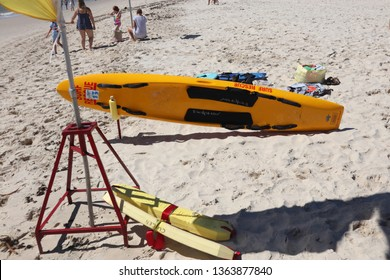 Kingscliff, NSW / Australia - March 31 2019 - Surf rescue equipment at a patrolled beach. Surf ski and rescue floats in the white sand next t the saftey flag