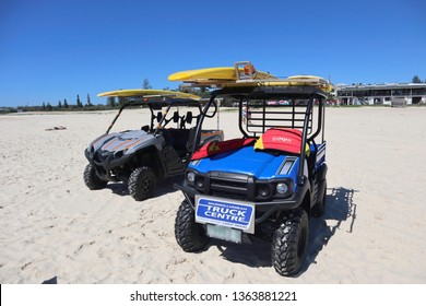 Kingscliff, NSW / Australia - March 31 2019 - 2 Kawasaki ATV,s on the beach for surf life saving club NSW Australia. One ATV blue the other grey with beach tyres and roll cage for saftey