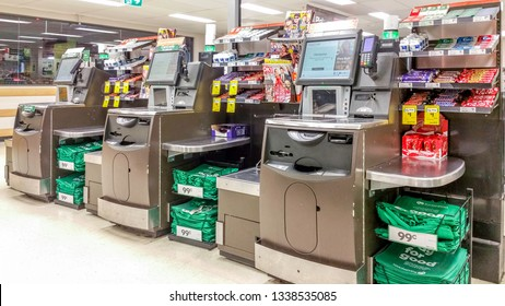 Kingsgrove, Australia - Dec 27, 2018: Self-service checkout kiosks at the local Woolworths supermarket.