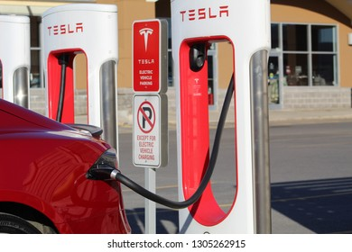 KINGSTON, CANADA - OCTOBER 19, 2018: Tesla Model S parked at Tesla Supercharger in Kingston, Ontario, Canada on October 19th, 2018.