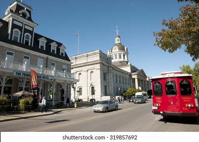 KINGSTON, CANADA - September 20, 2015: City scene depicting the city hall, the Prince George Hotel & Trolley tours on Ontario street