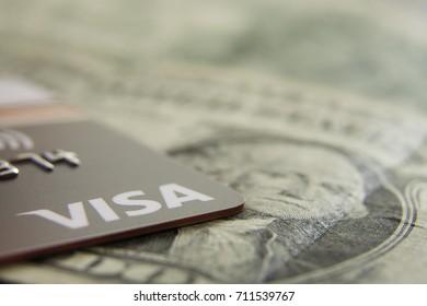 Kingston, Jamaica, 09.06.2017, Visa Card on top US currency