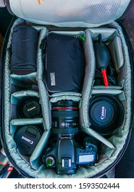 KINGSTON / JAMAICA - DECEMBER 17, 2019: TOP DOWN VIEW OF A DSLR/CAMERA BACKPACK WITH A CANON CAMERA, CANON LENSES, FILTERS AND AIR BLOWER