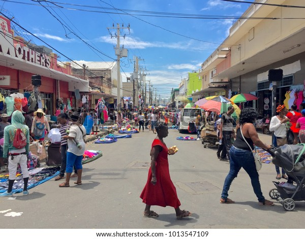 Kingston / Jamaica - March 2017: People in Kingston walking down the street and shopping during trade days.