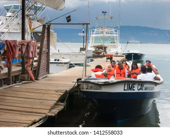 KINGSTON, JAMAICA - MAY 26, 2019: Tourists boarding a boat to Lime Cay in the Caribbean