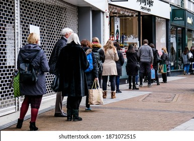 Kingston London, December 09 2020, A Line Of People Or Shoppers Queuing To Enter A Shop During COVID-19 Tier-2 Restrictions