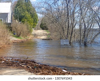 Kingston, New Brunswick / Canada - May 7 2018:  Water Covered Road at the Norton Shore Road Flooding in the Spring