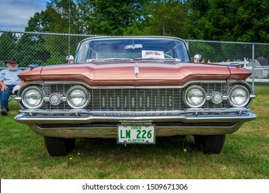 Kingston, Nova Scotia, Canada - August 24, 2019 : 1959 Oldsmobile Super 88  four door hard top sedan at Autos for Autism Show & Shine in Annapolis Valley region of Nova Scotia.