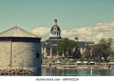 KINGSTON, ONTARIO, CANADA - MAY 27, 2017: A vintage style view of  Shoal Tower, a Martello tower and Kingston city hall from Kingston harbour in Kingston, Ontario, Canada.