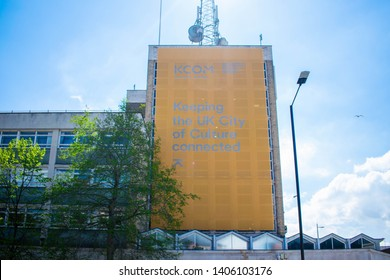 Kingston Upon Hull, Britain - 12th May 2019: The Kingston Communication Kcom logo sign, Keeping the UK City of Culture Connected. Business building in the city centre of Hull.