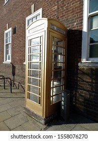 Kingston upon Hull, East Yorkshire, England - 23rd February 2018:  K6 Phone box in Hull Old Town painted gold to commemorate city's boxer, Luke Campbell, gold medal winner at 2012 Olympic Games.
