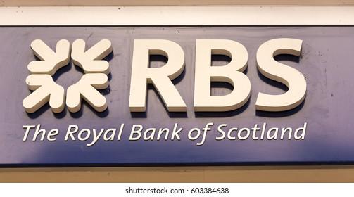 KINGSTON UPON THAMES, UK 18 MARCH 2017: RBS Bank Branch Sign, outside The Royal Bank of Scotland bank in Kingston upon Thames.