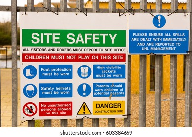KINGSTON UPON THAMES, UK 18 MARCH 2017: Building Site Safety Signes, fixed to railings.