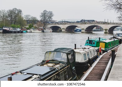 Kingston upon Thames, United Kingdom - April 2018: Local boat docking at Riverside Walk promenade by the River Thames in Kingston, England